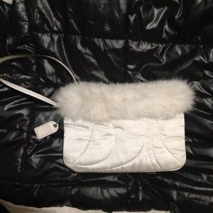 Coach wristlet with rabbit fur and white satin.